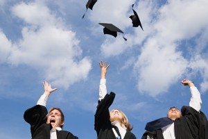 Graduates throwing their mortarboards in the air!